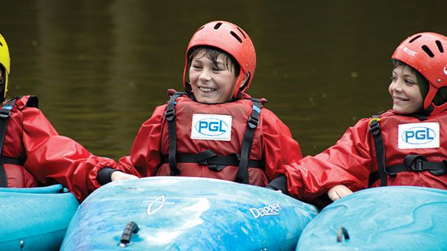 Young boy in a PGL canoe with his friends