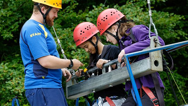PGL Instructor with two girls on the Giant Swing