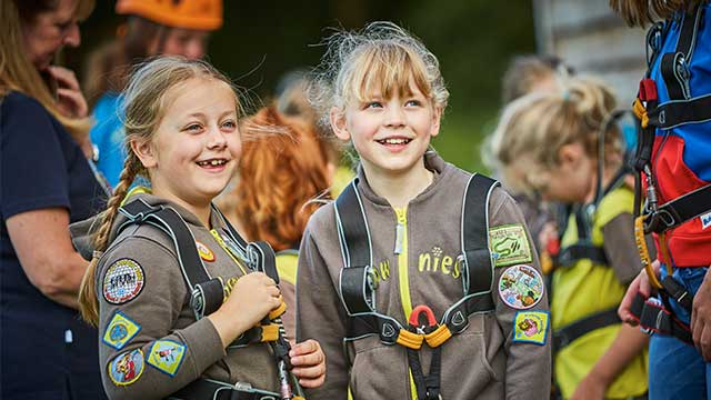 Two girls in Brownie uniforms, having fun at PGL