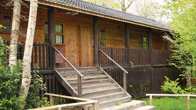 Wooden cabin style accommodation at PGL